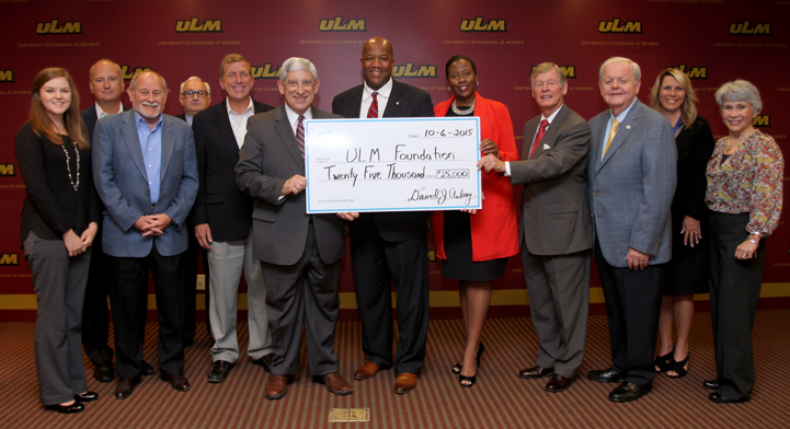 photo of dignitaries holding large check