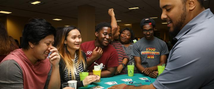 students playing game at casino night