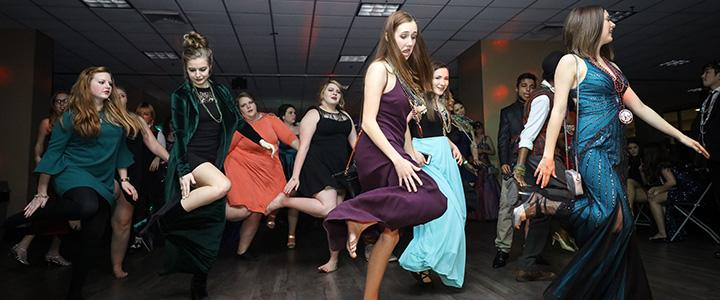 students dancing at the mardi gras ball
