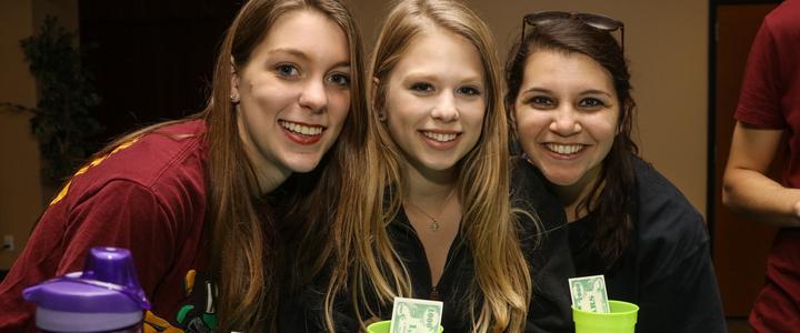 students at casino night smiling
