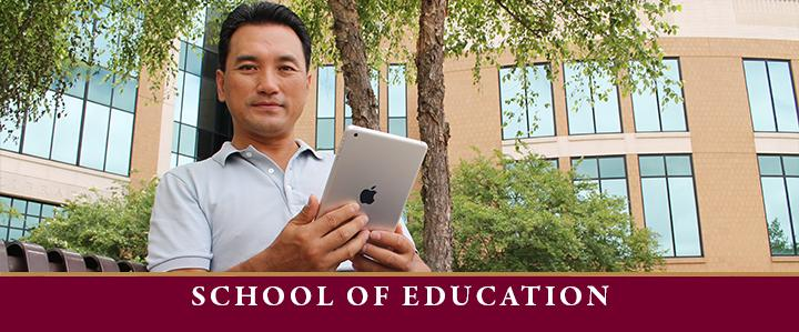 photo of education professor on tablet for education