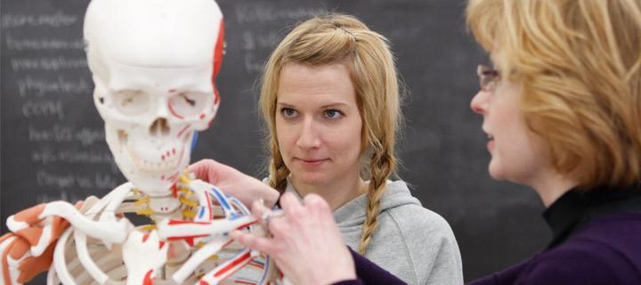 professor offering hands on instruction