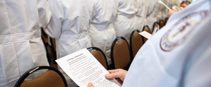 photo of nursing student reading pledge