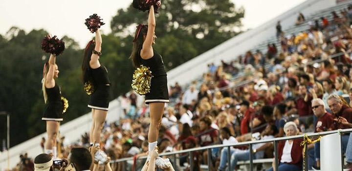 ULM Cheerleaders performing at football game