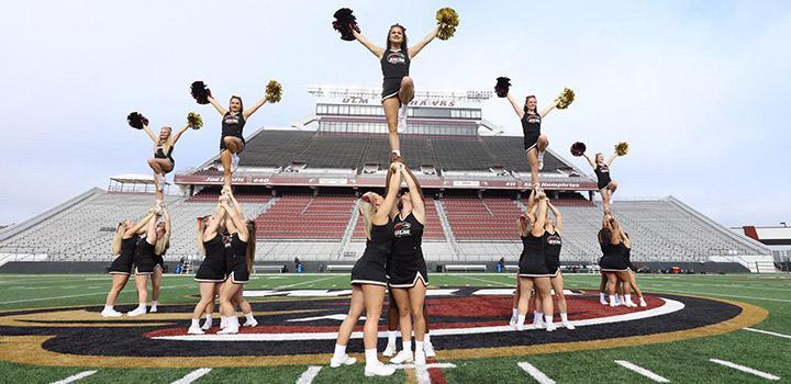 ULM Cheerleaders demonstrating routine at Malone Stadium