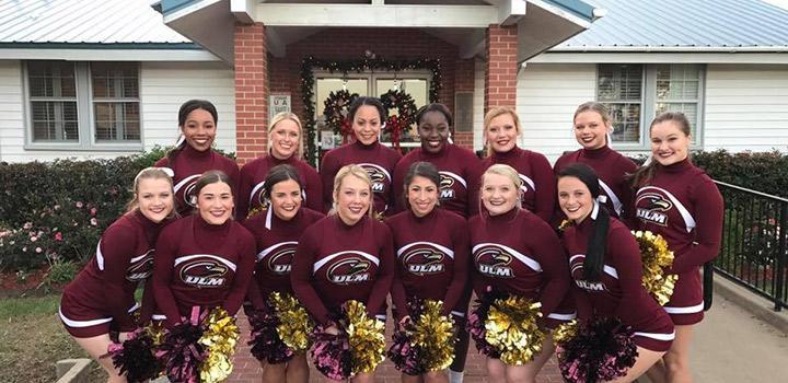 ULM Cheerleaders group photo at veteran's day event