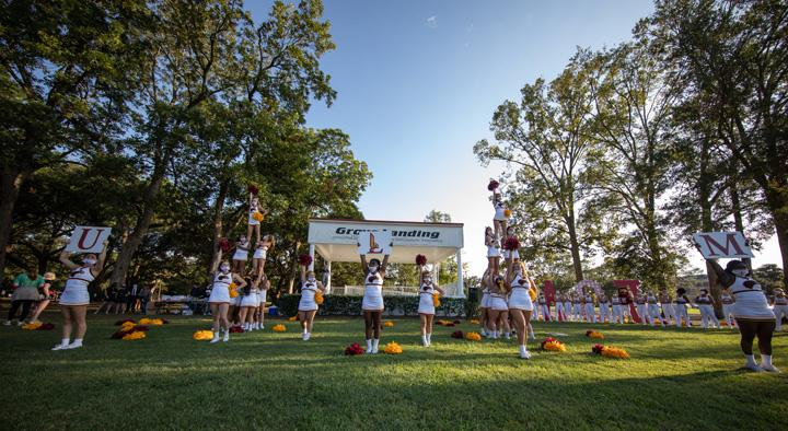 Cheer performing at Homecoming Event