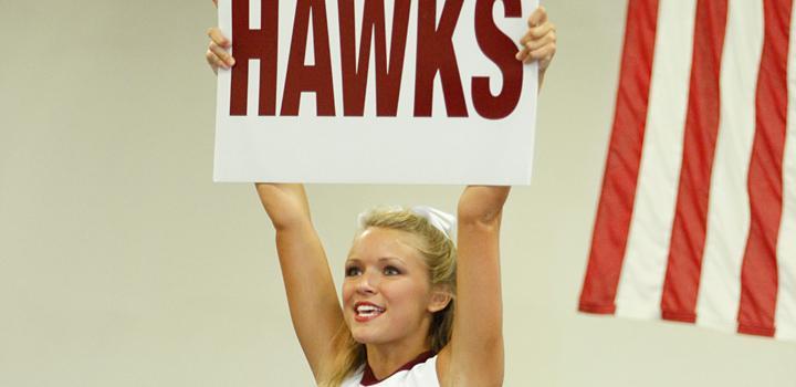 ULM Cheerleader holding up spirit sign
