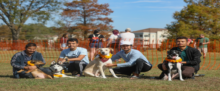 photo of students with dog