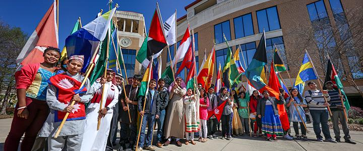 photo of international students with flags