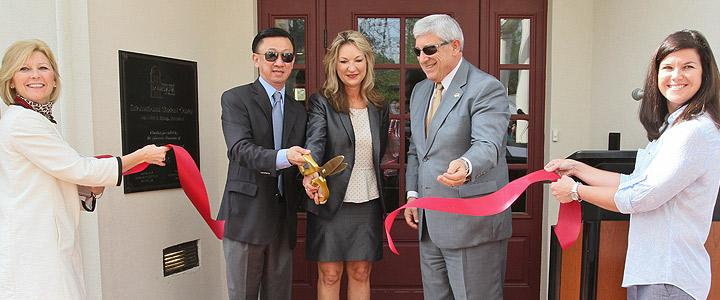 photo of ULM President and the Liews cutting ribbon