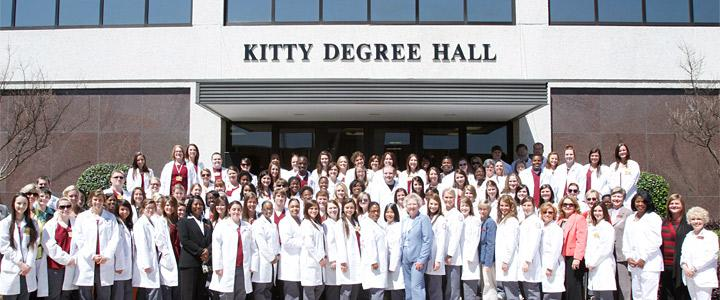 Nursing students and faculty at building entrance