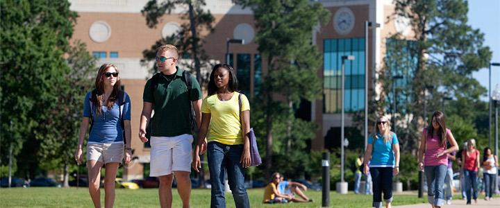 students walking on campus quad