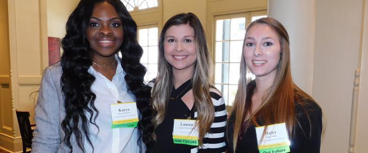 group shot of three RMI students