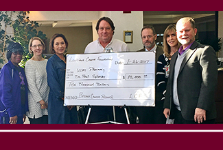 ULM pharmacy professor receives $10,000 donation for breast cancer research