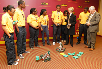 Photo of students and robotics
