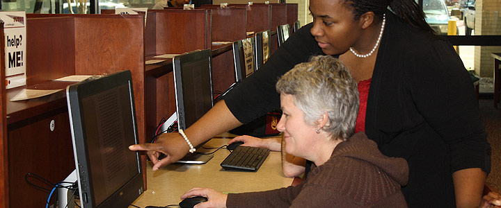 photo of two people at a computer