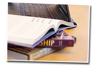 photo of laptop and books