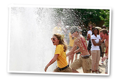 students playing in fountain
