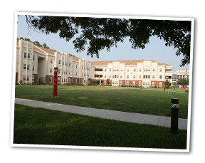 photo of lawn and residential hall